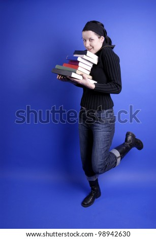 young woman with books on blue background