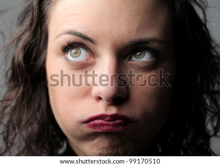 Young woman with bored expression - stock photo