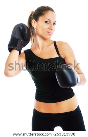 Young woman with boxing gloves on white background