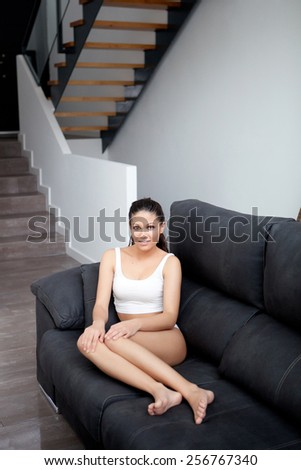 Young woman with brackets in underwear at home - stock photo