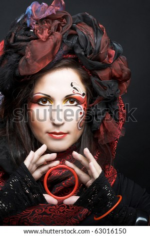 Young woman with bright make-up in exotic creative image. - stock photo