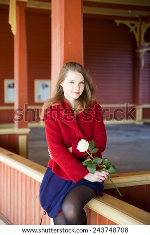 Young woman with bright skin and white rose - stock photo