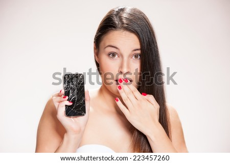 Young woman with broken phone. - stock photo