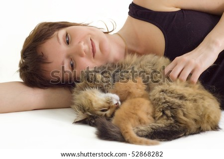 young woman with cat and eating kitten isolated on white background - stock photo