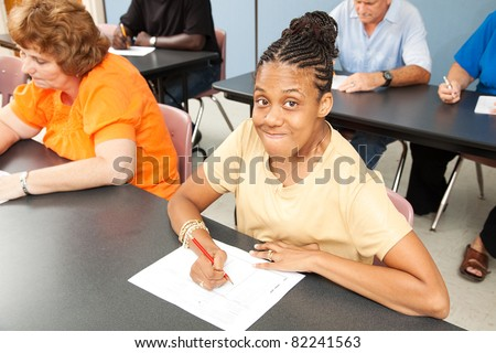 Young woman with cerebral palsy in college class. - stock photo