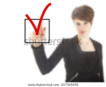 Young woman with checkbox isolated on white background - stock photo