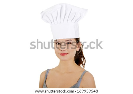 Young woman with chef hat. Isolated on white. - stock photo