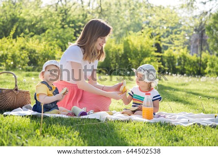 Young woman with children is resting in the park