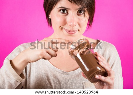 Young Woman with Chocolate Cream - stock photo