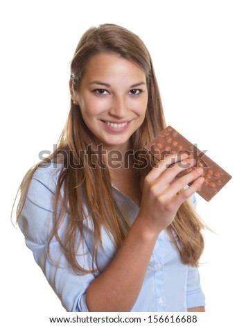 Young woman with chocolate her kitchen - stock photo