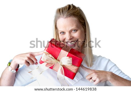 Young woman with Christmas present and cheerful smile isolated on white - stock photo