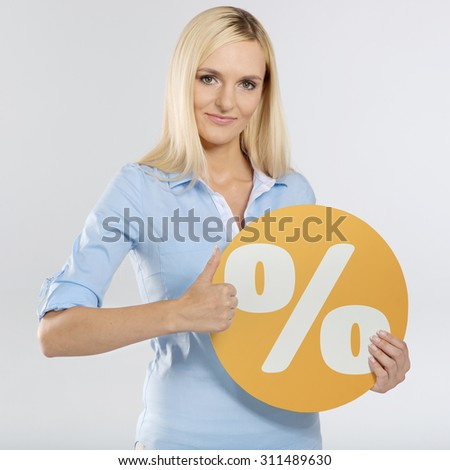 young woman with circle board and showing thumb up sign