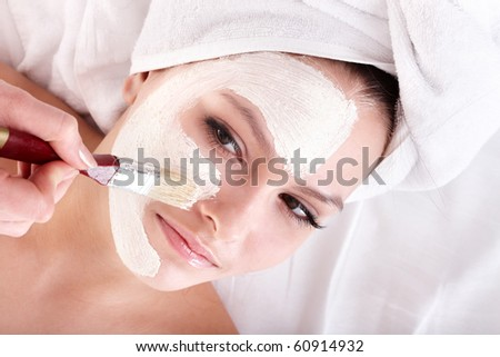 Young woman with clay facial mask. - stock photo
