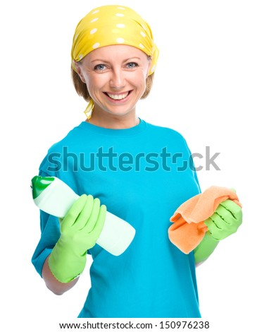 Young woman with cleaning liquid and rag, isolated over white - stock photo