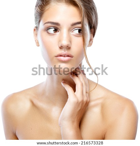 Young woman with clear face natural make up her hair up touching heck with her hand on a white isolated background - stock photo