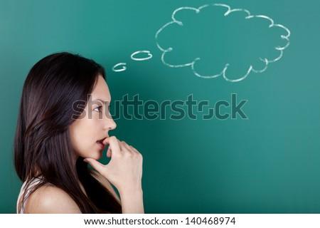 young woman with cloud drawn on blackboard - stock photo