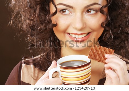 young  woman with coffee and cookies