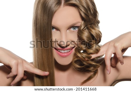 Young woman with cold hair keeps her hair in hands - stock photo