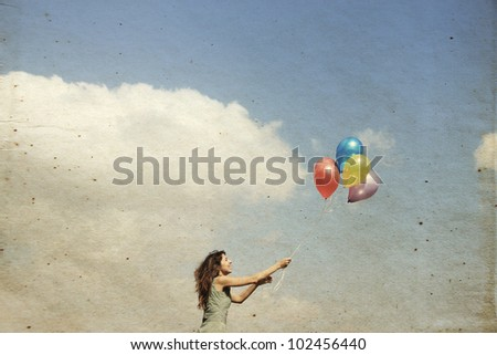 Young woman with colorful balloons - stock photo