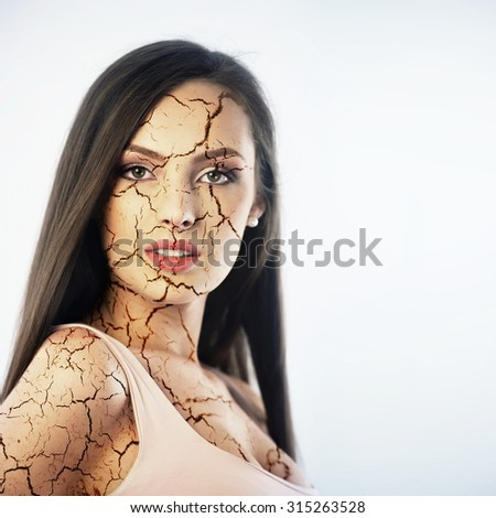Young woman with cracked skin. Cosmetology concept