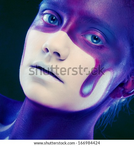 young woman with creative face-art - stock photo