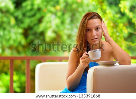 Young woman with cup of coffee. - stock photo
