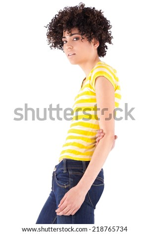 Young woman with curly hair and shirt with yellow stripes. - stock photo