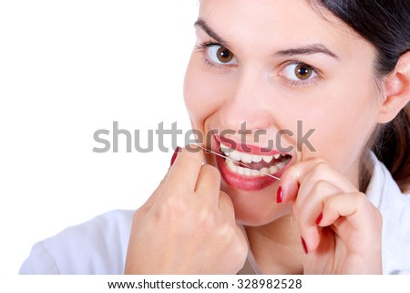 young woman with dental floss isolated on white - stock photo