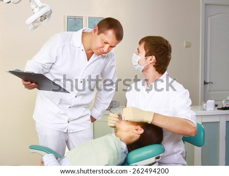 Young woman with dentist in a dental surgery. Healthcare - stock photo