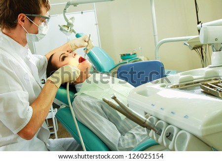Young woman with dentist in a dental surgery. Healthcare, medicine. - stock photo