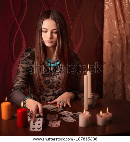 Young woman with divination cards in room - stock photo
