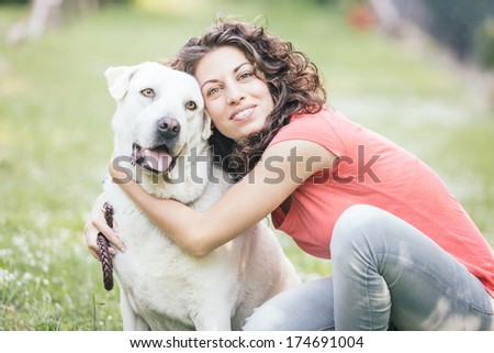 Young Woman with Dog - stock photo