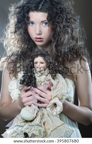 young woman with doll - stock photo