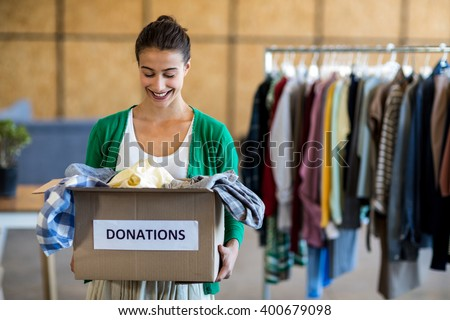 Young woman with donation box in the office - stock photo