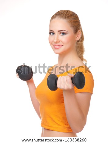Young woman with dumbbells isolated - stock photo