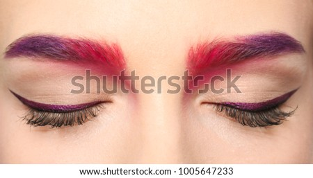 Young woman with dyed eyebrows, closeup