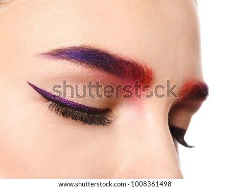 Young woman with dyed eyebrows on white background, closeup