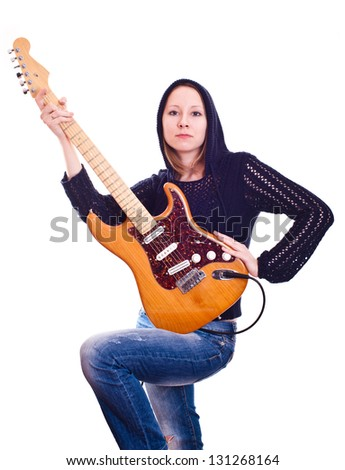 young woman with electric guitar - stock photo