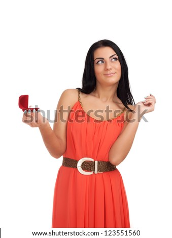 Young woman with engagement ring in box - stock photo