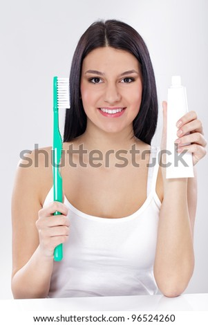 Young woman with Equipment for Oral Hygiene toothbrushes and  toothpaste - stock photo
