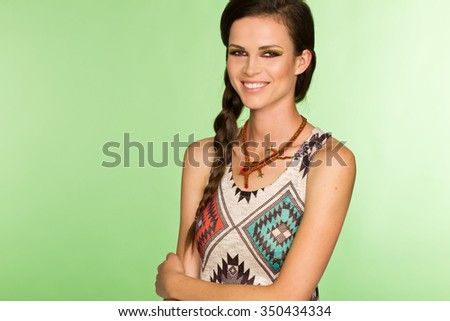 Young woman with ethnic t-shirt smiling  - stock photo