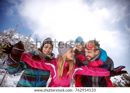 Young woman with family having fun on skiing