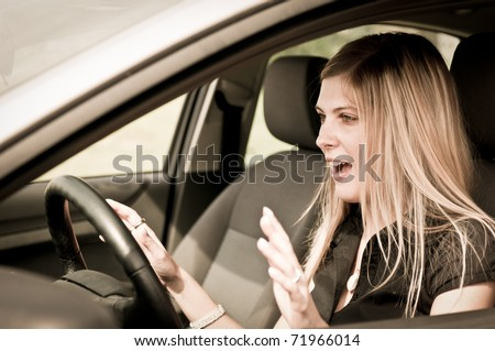 Young woman with fear in eyes driving car - hands not on steering wheel