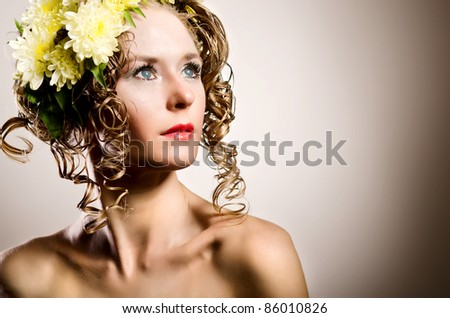 Young woman with field flowers