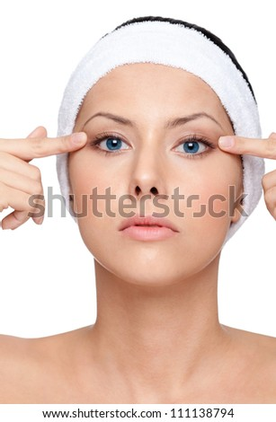 Young woman with flawless skin wants a plastic operation, isolated, white background - stock photo