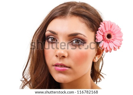 Young woman with flower in hair - stock photo