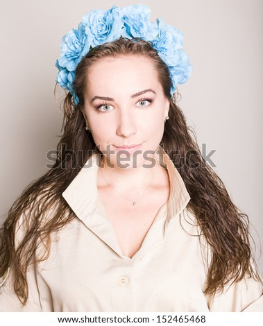young woman with flowers. studio - stock photo