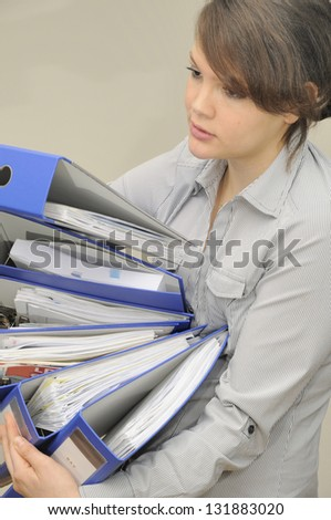 Young woman with folders - stock photo