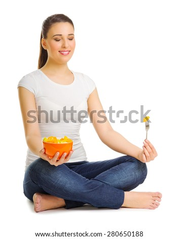 Young woman with fruit salad - stock photo