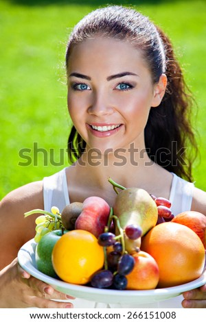 stock-photo-young-woman-with-fruits-heal